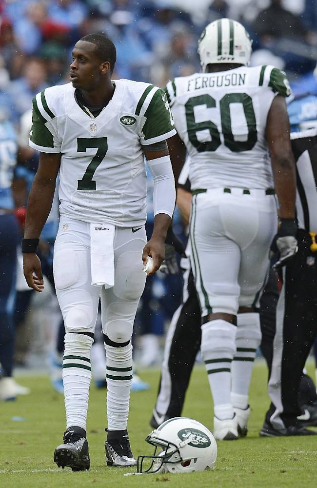 New York Jets quarterback Geno Smith (7) walks over to pick up his helmet after losing it in the second quarter of an NFL football game against the Tennessee Titans on Sunday, Sept. 29, 2013, in Nashville, Tenn