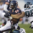Chicago Bears running back Matt Forte (22) is tackled by Philadelphia Eagles safety Malcolm Jenkins (27) and linebacker Connor Barwin (98) during the first half of an NFL preseason football game Friday, Aug. 8, 2014, in Chicago The Associated Press