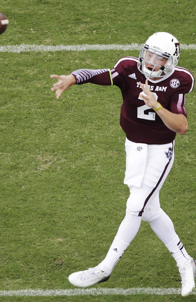 Texas A&M quarterback Johnny Manziel (2) passes against Alabama during the first quarter of an NCAA college football game Saturday, Sept. 14, 2013 in College Station, Texas