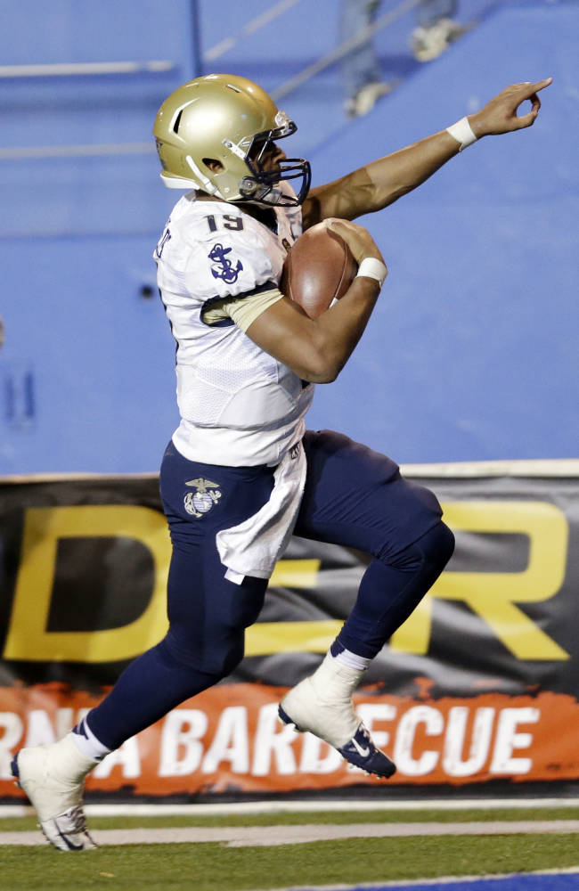 Navy quarterback Keenan Reynolds celebrates as he score the game-winning touchdown in  triple overtime for a 58-52 win over San Jose State in an NCAA college football game on Friday, Nov. 22, 2013, in San Jose, Calif.  N