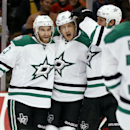 Dallas Stars center Shawn Horcoff, center, celebrates his goal against the Chicago Blackhawks with teammates Alex Goligoski, left, and Travis Moen, right, and during the first period of an NHL hockey game on Sunday, Nov. 16, 2014, in Chicago The Associate