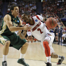 Mar 23, 2013; Lexington, KY, USA; Louisville Cardinals guard Russ Smith (2) dribbles against Colorado State Rams guard Dorian Green (22) in the first half during the third round of the NCAA basketball tournament at Rupp Arena. (Jamie Rhodes-USA TODAY Sports)