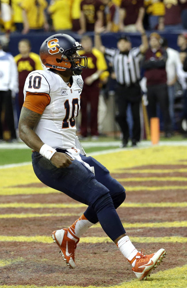 Syracuse quarterback Terrel Hunt (10) reacts after rushing for a touchdown against Minnesota during the fourth quarter of the Texas Bowl NCAA college football game on Friday, Dec. 27, 2013, in Houston. Syracuse won 21-17