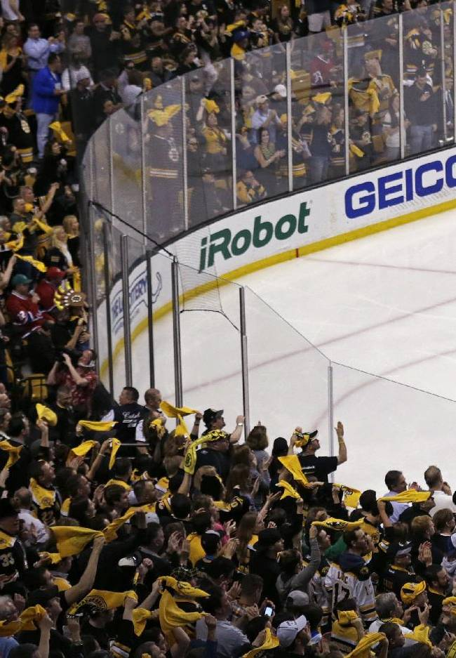 Boston Bruins fans cheer as they taunt Montreal Canadiens goalie Carey Price (31) after a goal by Bruins right wing Jarome Iginla, giving the Bruins a 3-0 lead, during the second period of Game 5 in the second-round of the Stanley Cup hockey playoff series in Boston, Saturday, May 10, 2014