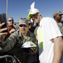 Green Bay Packers' Jordy Nelson has his picture taken with a fan after a practice session at Luke Air Force Base for the NFL Football Pro Bowl Thursday, Jan. 22, 2015, in Glendale, Ariz The Associated Press