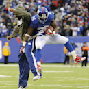 New York Giants running back Andre Brown, right, celebrates with running back Brandon Jacobs after scoring a touchdown against the Oakland Raiders during the second half of an NFL football game on Sunday, Nov. 10, 2013, in East Rutherford, N.J The Associa
