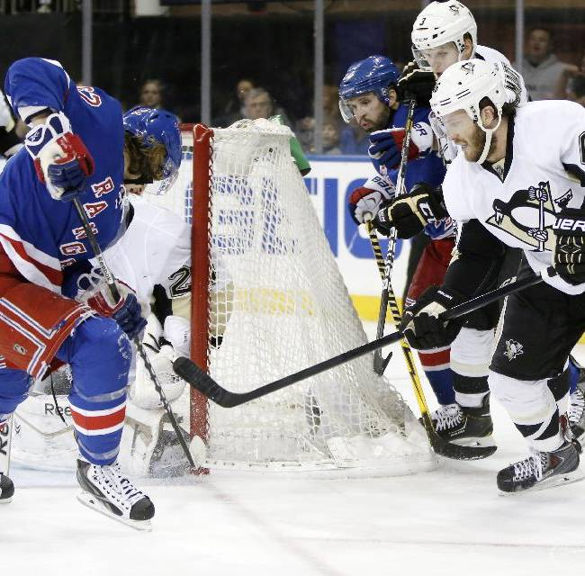 Pittsburgh Penguins center Joe Vitale (46) defends as New York Rangers left wing Carl Hagelin (62) looks for the puck in front of Pittsburgh Penguins goalie Marc-Andre Fleury in the second period of Game 6 of an NHL hockey second-round hockey playoff series, Sunday, May 11, 2014, in New York
