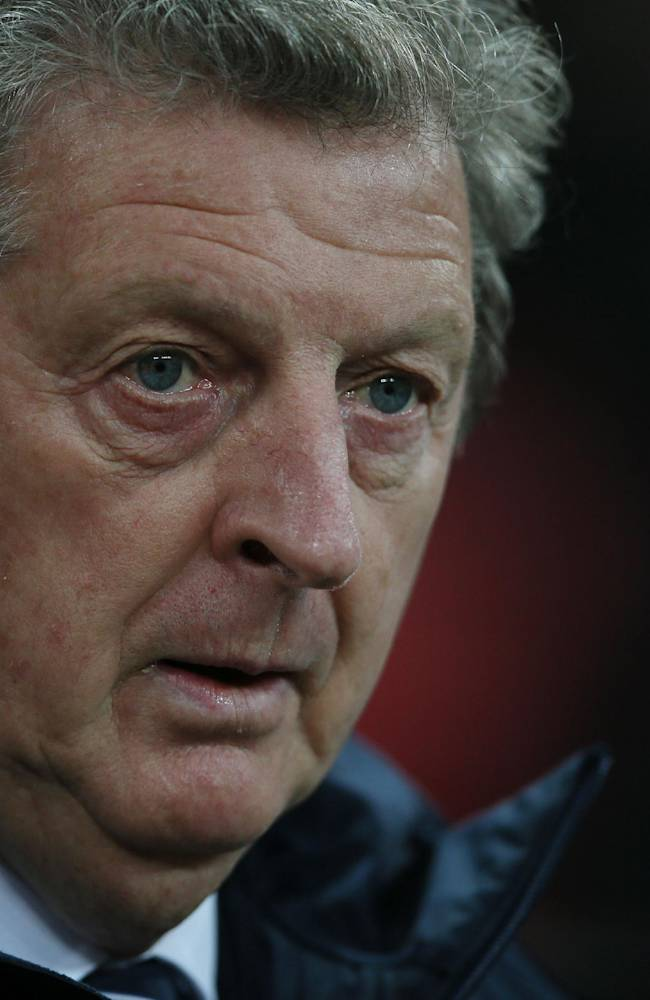 England's manager Roy Hodgson looks on from the dugout before the start of the international friendly soccer match between England and Germany, at Wembley Stadium in London, Tuesday, Nov. 19, 2013
