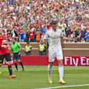 Real Madrid forward Gareth Bale, center, celebrates his penalty kick goal scored in the first half of a Guinness International Champions Cup soccer match with Manchester United at Michigan Stadium, Saturday, Aug. 2, 2014, in Ann Arbor, Mich. (AP Photo/Ton