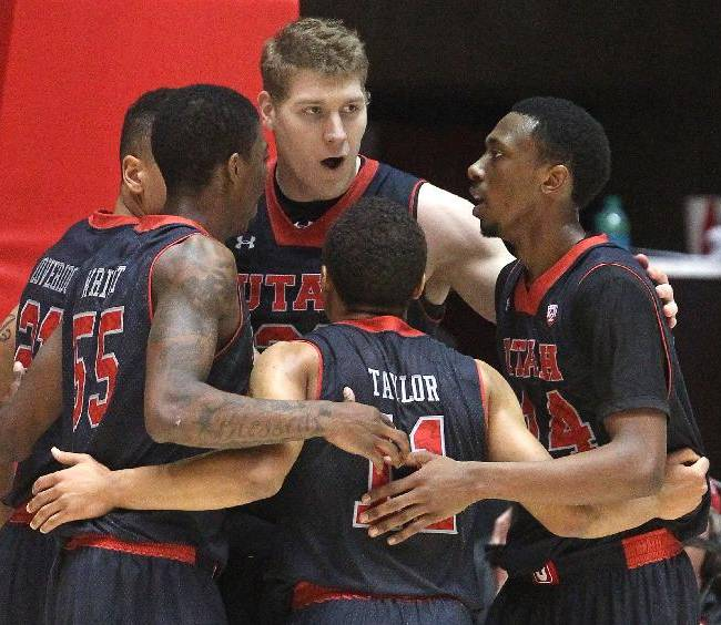 From left to right, Utah's Jordan Loveridge, Delon Wright, Dallin Bachynski, Brandon Taylor and Dakarai Tucker huddle in the second half during an NCAA basketball game  against Southern California Thursday, Jan. 16, 2014, in Salt Lake City. Utah won 84-66