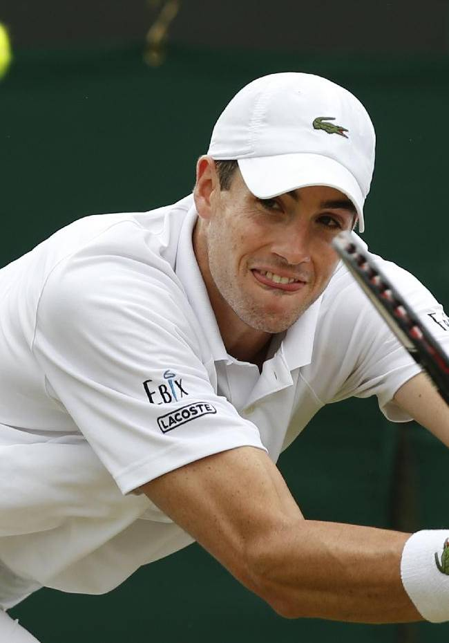 John Isner of the U.S. plays a return to Feliciano Lopez of Spain during their men's singles match at the All England Lawn Tennis Championships in Wimbledon, London, Monday, June 30, 2014