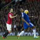 Chelsea's Didier Drogba, right, keeps the ball from Manchester United's Daley Blind during the English Premier League soccer match between Manchester United and Chelsea at Old Trafford Stadium, Manchester, England, Sunday Oct. 26, 2014