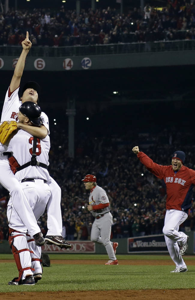 AP10ThingsToSee - Boston Red Sox relief pitcher Koji Uehara and catcher David Ross celebrate after getting St. Louis Cardinals' Matt Carpenter to strike out and end Game 6 of baseball's World Series Wednesday, Oct. 30, 2013, in Boston. The Red Sox won 6-1 to win the series