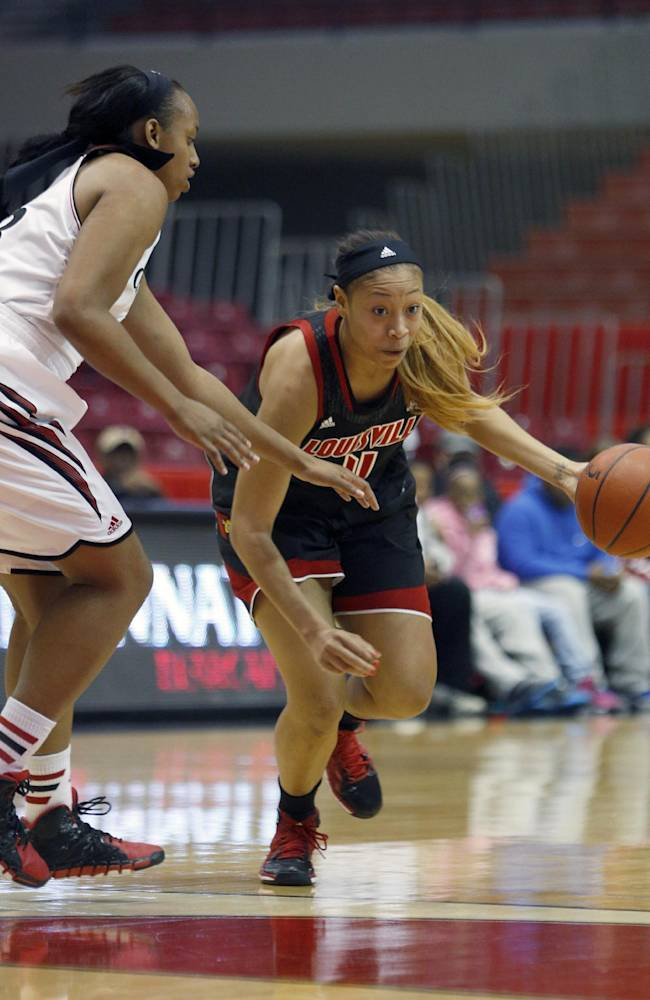 Louisville guard Antonita Slaughter (4) drives against Cincinnati forward Jeanise Randolph (33) during the first half of an NCAA  college basketball game, Saturday, March 1, 2014, in Cincinnati