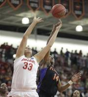 Ohio State's Ashley Adams (33) and Florida's Ndidi Madu (14) fight for a rebound, Sunday, March 18, 2012, during the first half of a first round NCAA college basketball game in Bowling Green, Ohio. (AP Photo/J.D. Pooley)