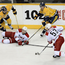 Carolina Hurricanes left wing Chris Terry (25) falls to the ice after passing the puck to Jeff Skinner (53) as they are defended by Nashville Predators defenseman Seth Jones (3) Filip Forsberg (9), of Sweden, in the first period of an NHL hockey game Tues