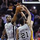 San Antonio Spurs' Kawhi Leonard, left, and Tim Duncan defend Los Angeles Lakers center Pau Gasol of Spain during the first half of an NBA basketball game Friday, March 14, 2014. (AP Photo/Bahram Mark Sobhani)