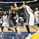 Charlotte Bobcats guard Kemba Walker (15) drives to the basket against Memphis Grizzlies defenders Mike Conley (11), Tayshaun Prince (21) and Marc Gasol (33), of Spain, in the first half of an NBA basketball game Saturday, March 8, 2014, in Memphis, Tenn