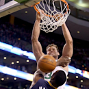 Boston Celtics center Kris Humphries (43) dunks the ball over Indiana Pacers center Ian Mahinmi (28), of France, as time expires at the end of the third quarter during an NBA basketball game on Saturday, March 1, 2014, in Boston The Associated Press