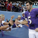 Baltimore Ravens quarterback Joe Flacco (5) greets fans after an NFL football game against the Miami Dolphins, Sunday, Dec. 7, 2014, in Miami Gardens, Fla. The Ravens defeated the Dolphins 28-13 The Associated Press