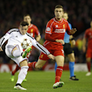 Basel's Taulant Xhaka, left, clears the ball from Liverpool's Jordan Henderson during the Champions League Group B soccer match between Liverpool and FC Basel at Anfield Stadium in Liverpool, England, Tuesday, Dec. 9, 2014