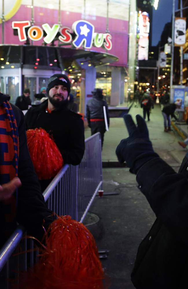 Seattle Seahawks fan Lynn Thomas, right, of Seattle, jokes with Denver Broncos fan Aaron Cassel, left, of Denver, Colo., about the possible outcome of the Super Bowl, Friday, Jan. 31, 2014 at Times Square in New York. The Seattle Seahawks will play the Broncos Sunday in the NFL Super Bowl XLVIII football game in East Rutherford, N.J