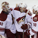 Arizona Coyotes goalie Devan Dubnyk, from left to right, Martin Hanzal, of the Czech Republic, and Antoine Vermette celebrate the team's 5-0 win over the Vancouver Canucks during an NHL hockey game in Vancouver, British Columbia, on Friday Nov. 14, 2014 T
