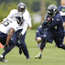 Seattle Seahawks running back Marshawn Lynch, right, rushes with the ball as defensive back DeShawn Shead closes (35) in on the final day of NFL football training camp, Wednesday, Aug. 13, 2014, in Renton, Wash The Associated Press