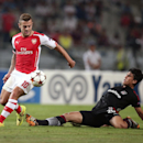 Besiktas's Necip Uysal, left, and Jack Wilshere of Arsenal fight for the ball during their Champions League play-off first leg soccer match in Istanbul, Turkey, Tuesday, Aug. 19, 2014. (AP Photo)