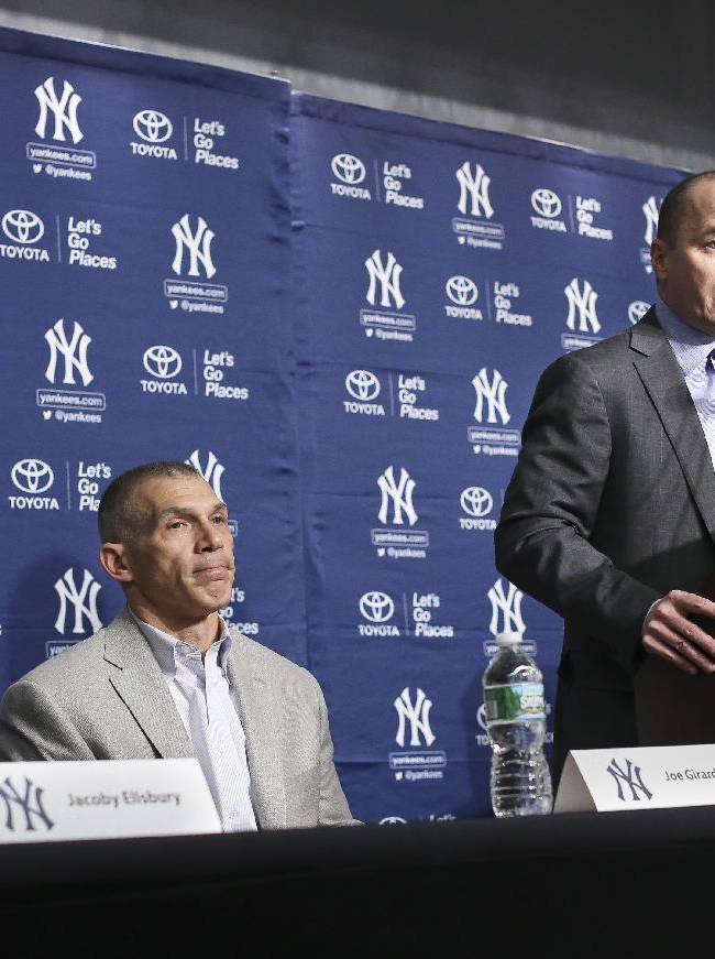 Brian Cashman, general manager of the New York Yankees, speaks during a news conference alongside team manager Joe Girardi, center, and Jacoby Ellsbury, left, at Yankee Stadium, Friday, Dec. 13, 2013, in New York. Ellsbury, the former Boston Red Sox outfielder, agreed to a $153 million, seven-year contract with the Yankees