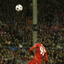 Liverpool's Mario Balotelli misses a chance during the Champions League group B soccer match between Liverpool and Real Madrid at Anfield Stadium, Liverpool, England, Wednesday Oct. 22, 2014
