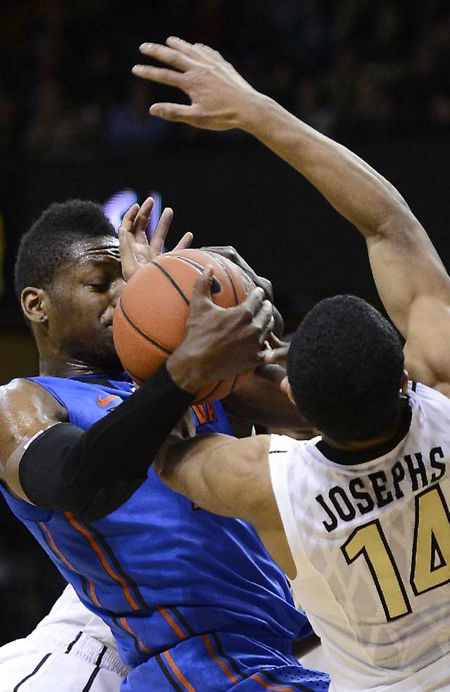 Florida forward Will Yeguete (15) grabs the ball away from Vanderbilt guard Carter Josephs (14) in the second half of an NCAA college basketball game, Tuesday, Feb. 25, 2014, in Nashville, Tenn. Florida won 57-54