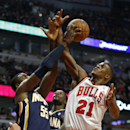 Chicago Bulls guard Jimmy Butler (21) vies for the ball with Indiana Pacers center Roy Hibbert (55) during the first quarter of an NBA basketball game in Chicago, Saturday, Nov. 16, 2013 The Associated Press