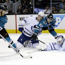 San Jose Sharks' Martin Havlat, left, of the Czech Rebpublic, scores past Toronto Maple Leafs goalie James Reimer, right, during the third period of an NHL hockey game Tuesday, March 11, 2014, in San Jose, Calif. San Jose won 6-2 The Associated Press