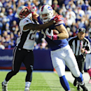 Buffalo Bills tight end Scott Chandler (84) fights New England Patriots strong safety Patrick Chung (23) to stay in bounds during the first half of an NFL football game Sunday, Oct. 12, 2014, in Orchard Park, N.Y The Associated Press