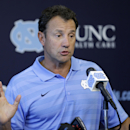 North Carolina coach Larry Fedora makes comments during an NCAA football media day in Chapel Hill, N.C., Saturday, Aug. 2, 2014. (AP Photo/Gerry Broome)