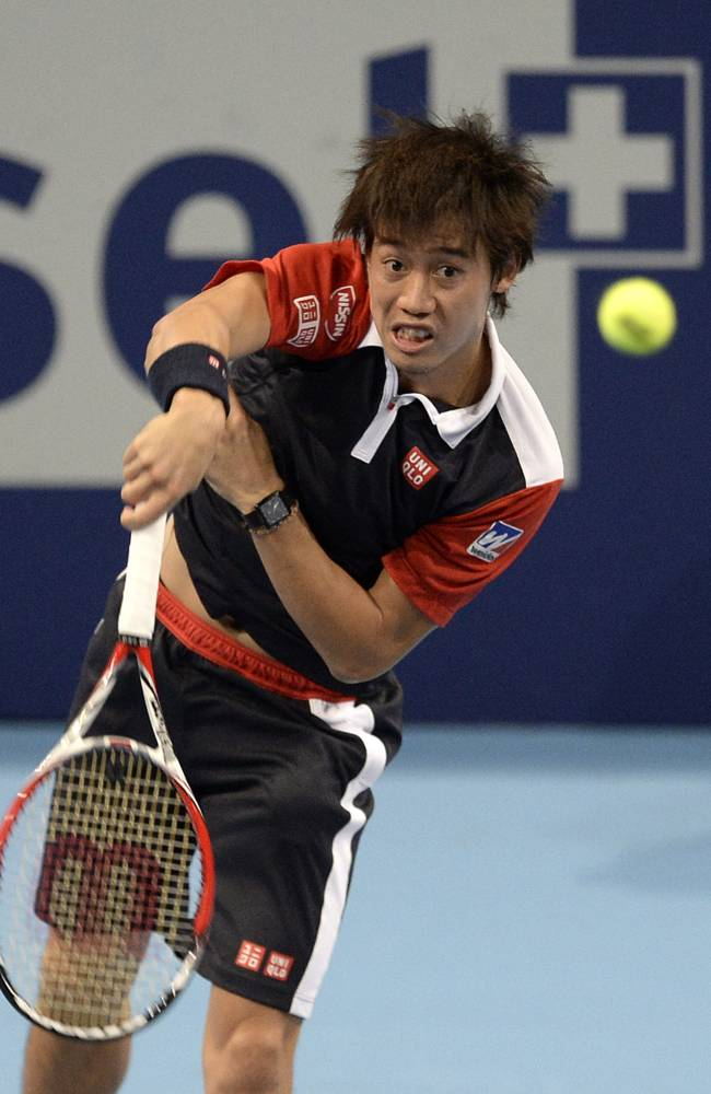 Japan's Kei Nishikori returns a ball to Switzerland's Marco Chiudinelli during their first round match at the Swiss Indoors tennis tournament at the St. Jakobshalle in Basel, Switzerland, on Tuesday, Oct. 22, 2013
