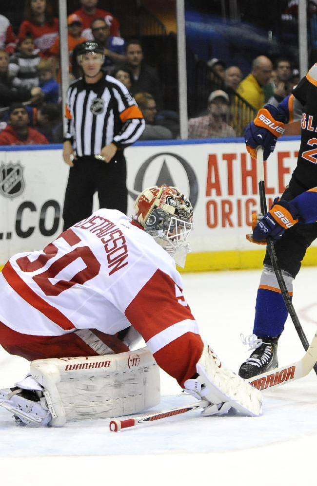 New York Islanders' Brock Nelson (29) lines up the puck to shoot against Detroit Red Wings goalie Jonas Gustavsson (50) to score in the second period of an NHL hockey game on Saturday, Nov. 16, 2013, in Uniondale, N.Y