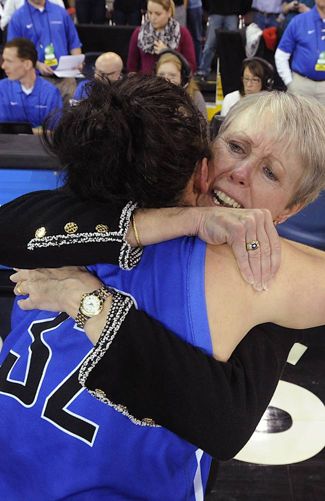 Bentley coach Barbara Stevens hugs Jacqui Brugliera after Bentley defeated West Texas A&M 73-65 to win the NCAA Division II women's basketball tournament championship, on Friday, March 28, 2014, in Erie, Pa
