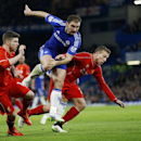 Chelsea's Branislav Ivanovic, center, battles for the ball between Liverpool's Alberto Moreno and Lucas Leiva, right, during the English League Cup semifinal second leg soccer match between Chelsea and Liverpool at Stamford Bridge stadium in London, Tuesd