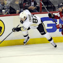 Pittsburgh Penguins center Sidney Crosby (87) lunges for the puck against Washington Capitals defenseman Mike Green (52) during the third period of an NHL hockey game, Monday, March 10, 2014, in Washington. The Penguins won 3-2 The Associated Press