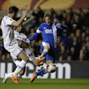 Dnipro's Ivan Strinic, right, gets a shot past Tottenham's Jan Vertonghen, left, and Kyle Naughton during the Europa League Group K soccer match between Tottenham Hotspur and Dnipro at White Hart Lane stadium in London, Thursday, Feb. 27, 2014