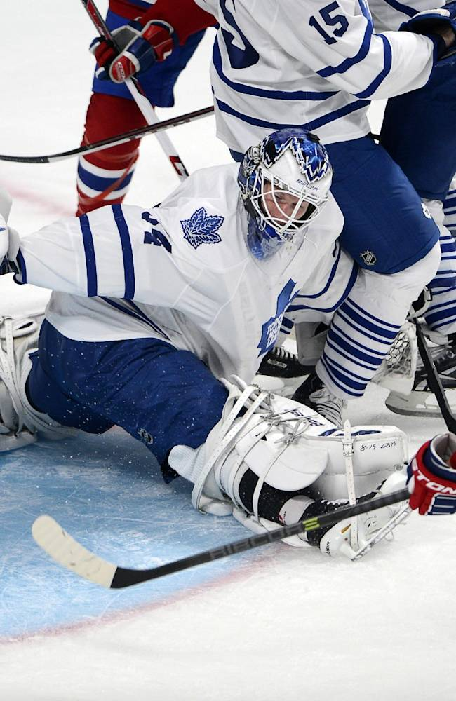 Montreal Canadiens center Lars Eller (81), from Denmark, scores a goal against Toronto Maple Leafs goalie James Reimer (34) during first period of an NHL hockey game on Tuesday, Oct. 1, 2013 in Montreal