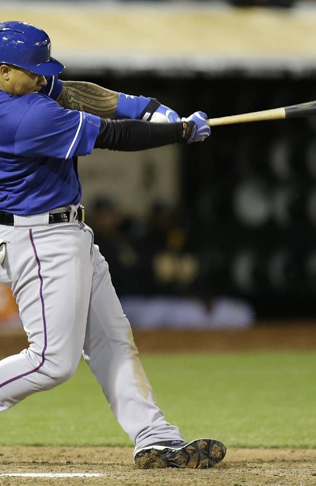Rangers rally for two runs in ninth to beat A's