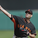 CORRECTS TO SCOTTSDALE NOT PHOENIX - San Francisco Giants starting pitcher Tim Hudson throws against the Arizona Diamondbacks during the first inning of a spring exhibition baseball game on Sunday, March 2, 2014, in Scottsdale, Ariz The Associated Press