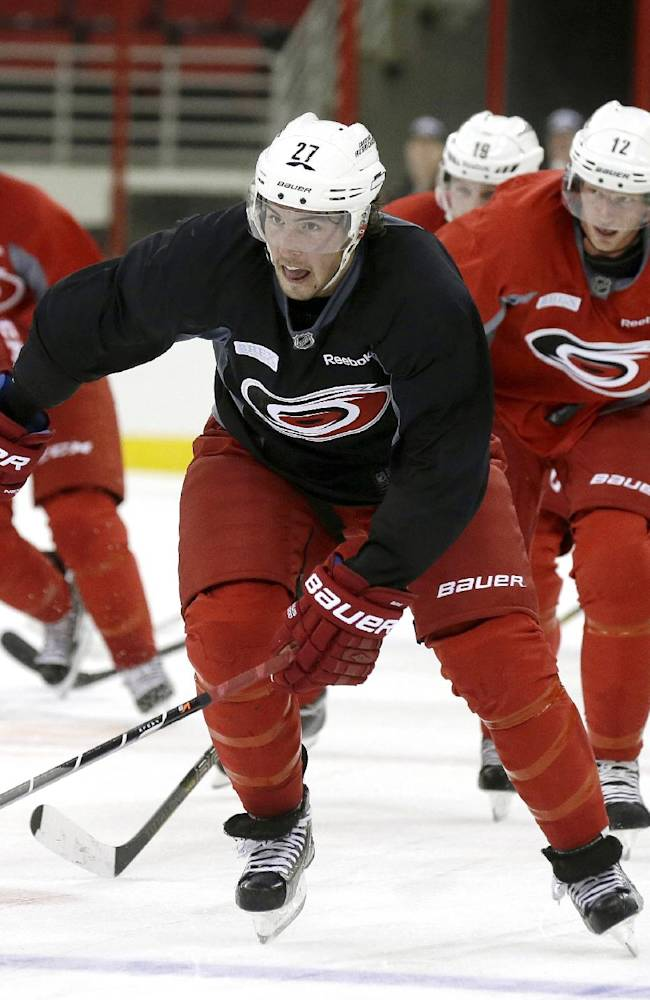 In this photo taken Thursday, Sept. 12, 2013, Carolina Hurricanes' Justin Faulk (27) skates during the first day of NHL hockey training camp in Raleigh, N.C. The NHL's realignment meant the end of the Southeast Division and placed the Hurricanes into the new Metropolitan Division