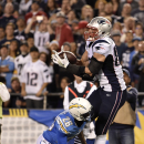 New England Patriots tight end Rob Gronkowski grabs a touchdown pass over San Diego Chargers cornerback Brandon Flowers during the first half in an NFL football game Sunday, Dec. 7, 2014, in San Diego The Associated Press
