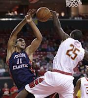 Florida Atlantic center Justin Raffington, left, is fouled by Maryland forward Jonathan Graham as he goes up for a shot in the first half of an NCAA college basketball game in College Park, Md., Saturday, Dec. 14, 2013. (AP Photo/Patrick Semansky)