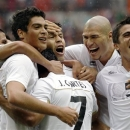 FILE - In this Aug. 7, 2012 file photo, Mexico's Javier Cortes, (7) celebrates with his teammates Raul Jimenez, left, Oribe Peralta, Jorge Enriquez and Darvin Chavez, right, after scoring during the men's soccer semifinal match between Japan and Mexico at Wembley Stadium, at the 2012 Summer Olympics in London.  Mexico won the gold medal at the 2012 London Olympics, and it will use the same base of young players to make an impression at the Confederations Cup. (AP Photo/Luca Bruno, File)