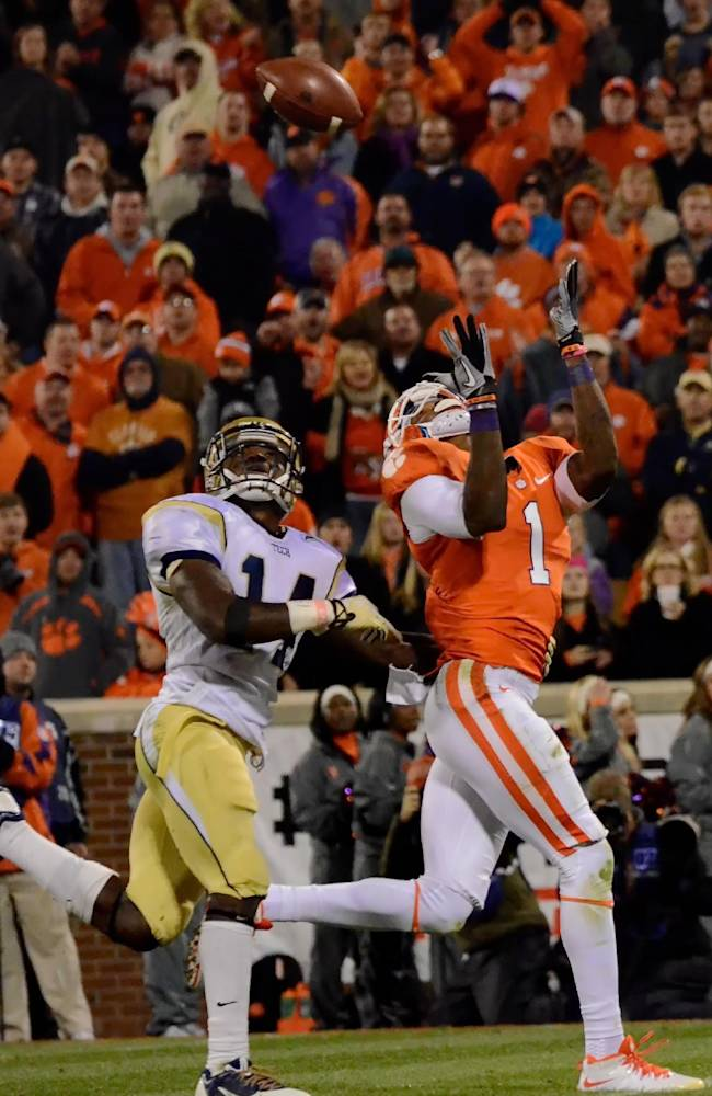 Clemson's Martavis Bryant pulls in a reception over Georgia Tech's Jemea Thomas for a touchdown during the first half of an NCAA college football game Thursday, Nov. 14, 2013, at Memorial Stadium in Clemson, S.C